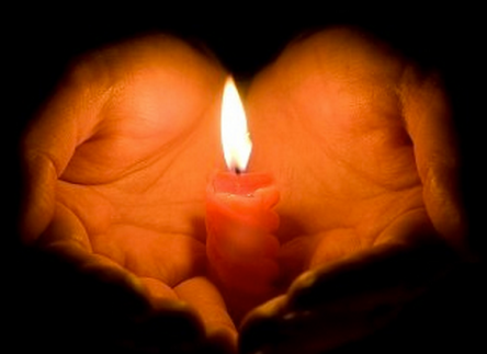 candle in cupped hand
